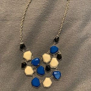 Necklace with blue, black, and white/cream colors